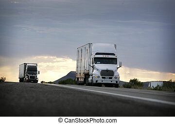truck driving on a freeway at sunset