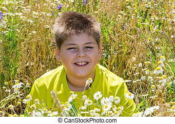 Boy in a field with flowers