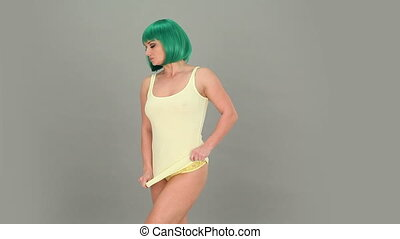 sexy woman with a green hair wearing yellow knickers showing...