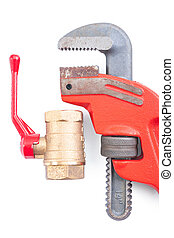 plumbing fixture and adjustable wrench close up isolated