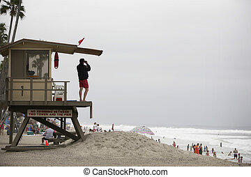 lifeguard observing a beach scene in california