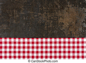 Antique baking tray with a red checkered tablecloth