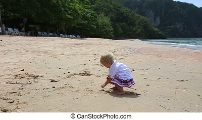 girl in Ukrainian costume embroidery on beach