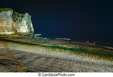 Natural cliff in Etretat, France. Night scene. - One of the...