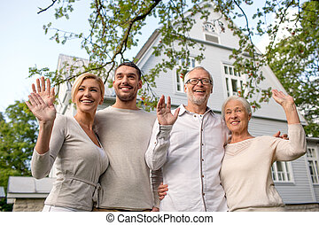 happy family in front of house outdoors - family,...