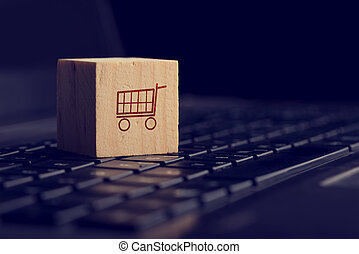 Online shopping and e-commerce background with a wooden cube...