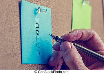 Man doing an evaluation on a notice board - Man doing an...