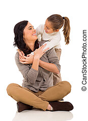 young girl hugging mother