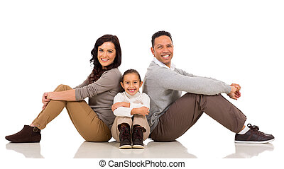 family sitting on the floor - beautiful family sitting on...