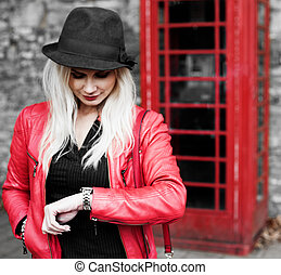 Impatient young woman checking her watch