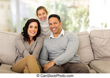 family of three relaxing at home - happy family of three...
