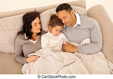 family sleeping together on the couch - above view of family...