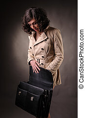 business woman opening a suitcase looking surprise