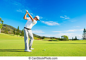 Man Playing Golf - Golfer Hitting Golf Shot with Club on the...