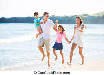 Happy Family on the Beach - Happy Mixed Race Family of Four...