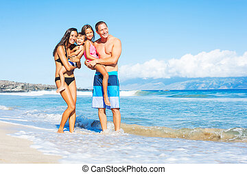 Happy Mixed Race Family on the Beach - Happy Mixed Race...