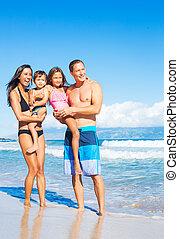 Happy Mixed Race Family on the Beach - Happy Mixed Race...