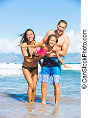 Family on the Beach - Happy Family Playing and Having Fun on...