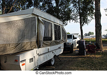 Shady Campsite - Pop-up camper is hooked up to electricity...