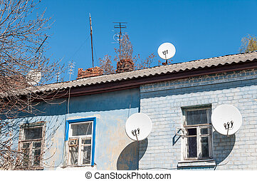 Antenna. The old house. Satellite dish.