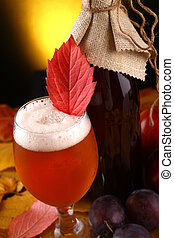 Autumn beer - A glass and a bottle of beer standing over...