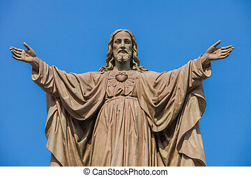 Outdoor Statue of Jesus with Open Arms