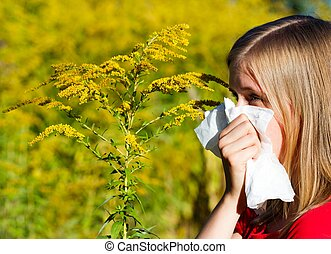 Bad Ragweed Allergy - Young woman blowing nose in...