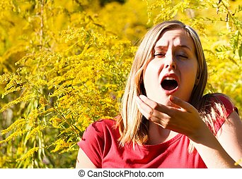 Allergic To Ragweed - Young woman sneezing because of...
