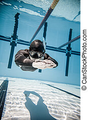 Freediver Performing during a DYN Freediving Competition -...