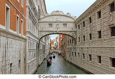 Bridge of sighs in Venice with gondolas on the Canal - Great...