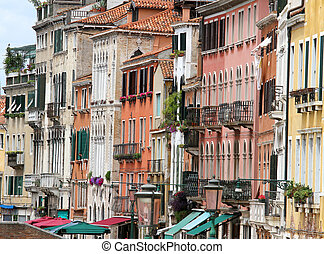 Venetian-style buildings with facades of many colors in...