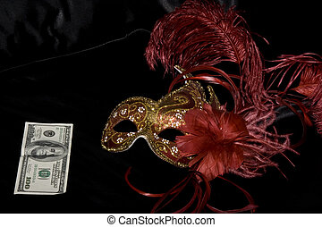 Venetian mask and dollars on the bed