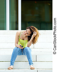 Young woman relaxing outdoors