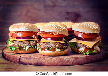 Mini beef burgers - Selective focus on the front mini beef...