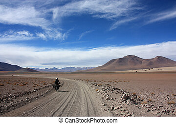 Motorbike on offroad track in Bolivia near the Dali Valley