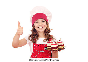 happy little girl with raspberry cake and thumb up