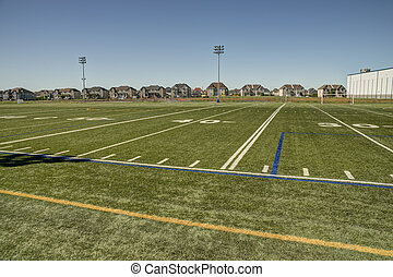 Football field - American football field with goal post in...