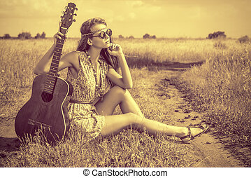 pretty retro - Romantic girl travelling with her guitar...