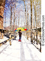 Child Walking on Wood Trail with Snow