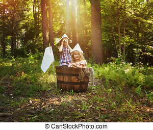 Children Fishing in Wooden Boat in Forest - A little boy and...