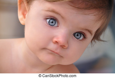 Little Baby Blue Eyes Closeup Portrait - A young baby is in...