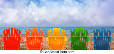 Vacation Beach Chairs on Sand - A rainbow of colors of...