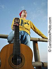 modern musician posing with guitar - modern musician posing...