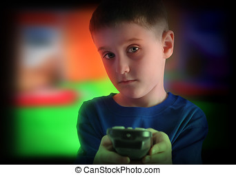 Child Watching Television with Remote Control - A young boy...
