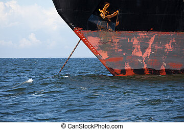 Freighter in anchor - A freighter in anchor on the open sea...