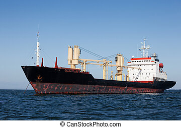 Freighter in anchor - A freighter in anchor on the open sea....