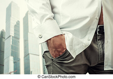Man's hand in white shirt with cufflink - Man's hand in a...