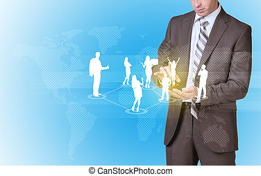 Businessman and world map with business people silhouettes -...