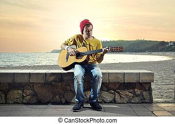 modern musician posing with hish guitar - modern musician...