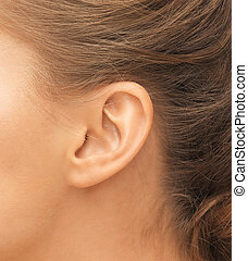 close up of womans ear - hearing, health, beauty and...